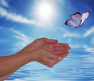 Reiki-Butterfly-flying-free-from-cupped-hands